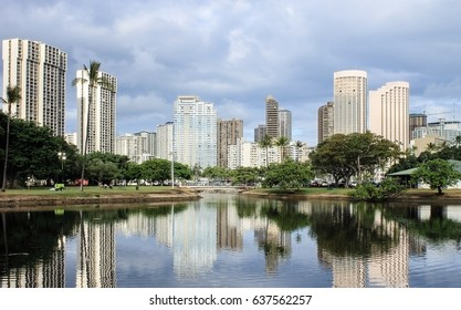 Buildings reflecting on a lagoon at Ala Moana Bay Beach Park, Honolulu, Hawaii..