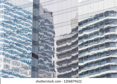the buildings reflection on the mirror wall of other buildings in the capital city