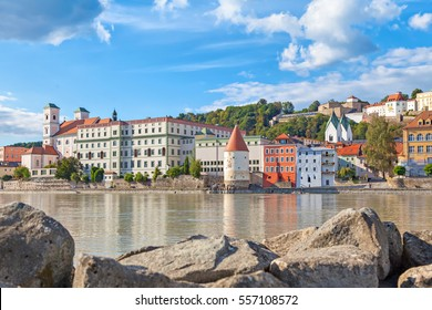 Buildings and Schaibling Tower on the side of Inn river near its confluence with Danube in Passau, Bavaria, Germany