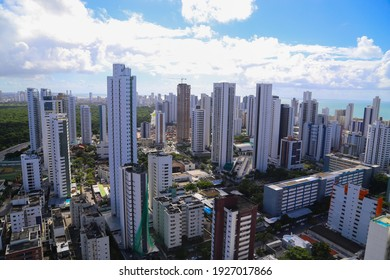 A lot of buildings with the sea behind at Recife