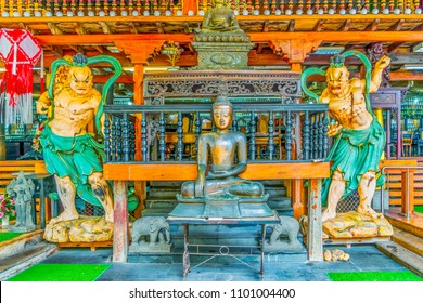 Buildings and statues in a Buddhist Temple in Colombo, Sri Lanka.
