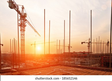 buildings under construction with sunset