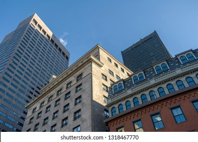 Buildings in various architectural styles looming over Boston street