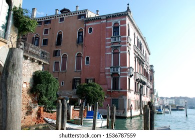 Buildings of Venice Italy, wooden doors and windows with typical arcades balcony with baluster lantern typical of the place in the Grand Canale on a sunny winter day