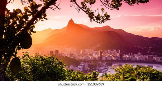 Buildings at the waterfront with Christ The Redeemer statue in the background, Corcovado, Rio de Janeiro, Brazil