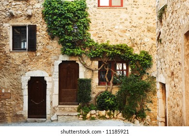 Buildings with windows and doors in the quaint little French hilltop village of Saint-Paul de Vence, Southern France,  Alpes Maritimes, next to the Mediterranean sea - A Heritage Site