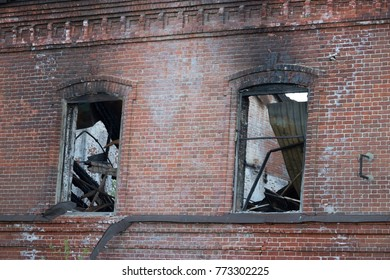 builing after a fire. burned windows and roof