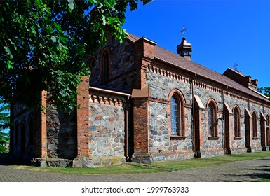 Built in 1878 in the neo-Gothic style of stone, the Catholic Church of Annunciation of the Blessed Virgin Mary in the village of Lachowo in Podlasie, Poland. - Shutterstock ID 1999763933