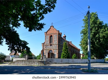 Built in 1878 in the neo-Gothic style of stone, the Catholic Church of Annunciation of the Blessed Virgin Mary in the village of Lachowo in Podlasie, Poland. - Shutterstock ID 1999763945