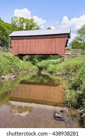 Built in 1888, Center Point Covered Bridge is reflected on the waters of The Talkington Fork of McElroy Creek in rural Doddridge County, West Virginia.