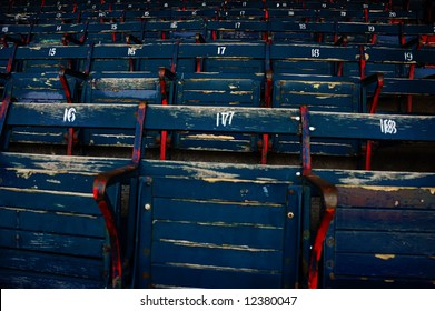 Built in 1912, Fenway Park is one of the best known and most historic landmarks in the city of Boston. View of the original old style wooden seats inside of the park.