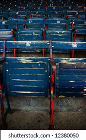 Built in 1912, Fenway Park is one of the best known and most historic landmarks in the city of Boston. Original wooden baseball seats used in the park.