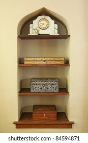 Built in shelf with boxes and clock