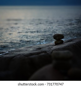 Built of stone inukshuk statue on the sea coast