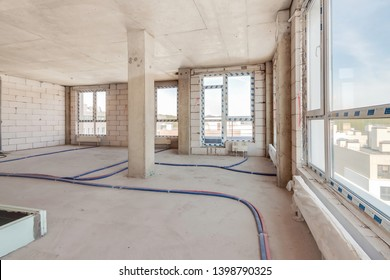 Built structure of residential apartment building interior in progress to new house with large panoramic windows and white brick wall. Empty modern light room under repairing work – Image
