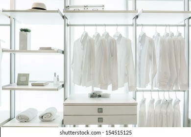 Built-in wardrobe Interior, with shirts, drawers, racks, frame, towel, hat, and book