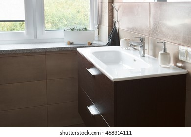 Built-in white sink in the large bathroom next to the window