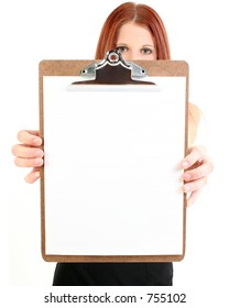 Buisiness woman holding up a blank clipboard. Focus on clipboard.