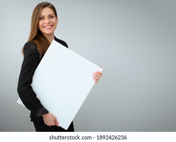 Buisness woman holding white banner with copy spase. Isolated female portrait.