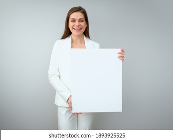Buisness woman holding white empty banner. Isolated on white back female portrait.