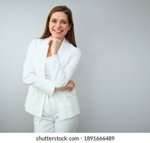 Buisness woman in white suit standing near to copy spase. Isolated female portrait.