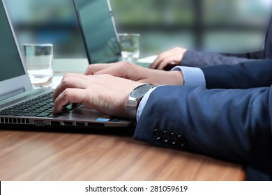 The Buisness Workers At Desks with a laptop In Busy Creative Office
