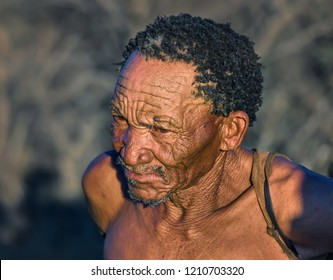 BUITEROS, NAMIBIA - JULY 17, 2014: Close-up portrait hunter Bushman. The San people, also known as Bushmen are members of various indigenous hunter-gatherer peoples of Southern Africa