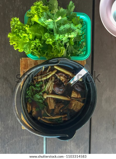 Buk Kut Teh, a Chinese pork soup dish, eat with rice and some vegetable