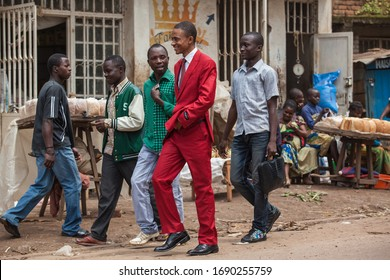 Bukavu, Democratic Republic of the Congo - January 2013: stylish man in red suit congolese society of les sapeurs
