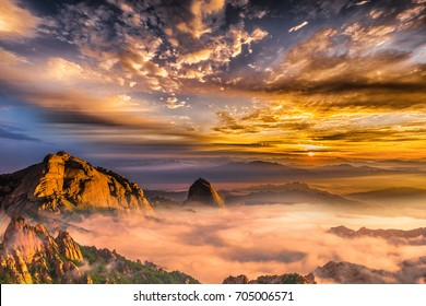 Bukhansan mountains is covered by morning fog and sunrise in Bukhansan National Park in Seoul,Korea.