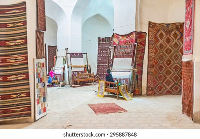 BUKHARA, UZBEKISTAN - APRIL 28, 2015: The rug store is also a workshop, here people can watch rugs manufacturing, on April 28 in Bukhara.