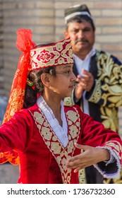 BUKHARA, UZBEKISTAN - APRIL 30, 2018: Dancer wearing traditional dress in the center of Bukhara, Uzbekistan