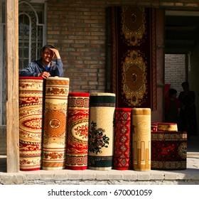 Bukhara, UZBEKISTAN - March 08, 2009: Sale of carpets on the market in Bukhara