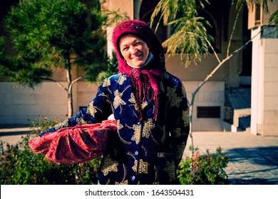 Bukhara, Uzbekistan. November 2012 | Uzbek woman of advanced years in national dress.