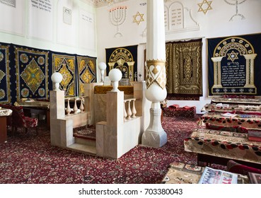 BUKHARA, UZBEKISTAN - OCTOBER 19, 2016: Interior of very first synagogue in Bukhara, hall of festive worship. Bima is platform in the center of synagogue and a table for public reading of the Torah.
