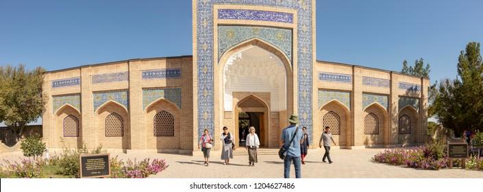 Bukhara, Uzbekistan - September 23, 2018 :  Tourists at entrance to the Mausoleum of Bahouddin Nakshband, or Bakhuddin Nakshbandi, founder of Sufism in Bishkek, Uzbekistan.