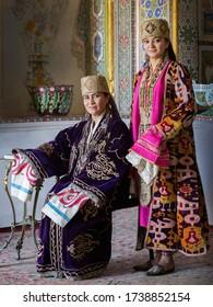 Bukhara, Uzbekistan.05.08.2018 G. Models present old Bukhara women's clothing with gold embroidery and jewelry in Bukhara, Uzbekistan