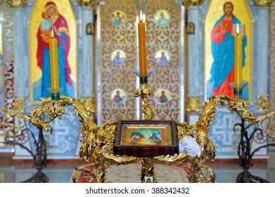 BUKI, UKRAINE - MAY 01, 2015.Church of St. Eugene, interior. Candles burning in church