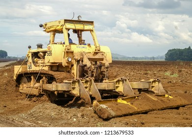 "Bukidnon, Mindanao, Philippines - November 14 2009: Heavy machines are used in the pineapple plantations of ""Camp Phillips"", a US owned estate for growing pineapples"