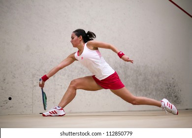 BUKIT JALIL, MALAYSIA  - SEPTEMBER 12: Jenny Duncalf stretches to make a return at the CIMB Malaysian Open Squash Championship 2012 on September 12, 2012 at the National Squash Centre, Malaysia.