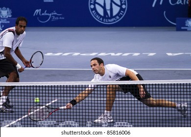 BUKIT JALIL- OCT 01: Scott Lipsky (right) volleys at the Malaysian Open semi-final doubles game partnering Rajeev Ram against Butorac/Rojer on October 01, 2011 in Putra Stadium, Bukit Jalil, Malaysia.