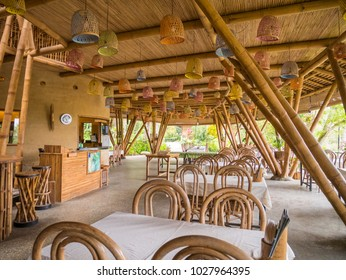 Bukit Lawang, Indonesia - February 11 2018: Interior of Kapal Bambu (Bamboo Ship) Restaurant with no visitor at noon. Usually crowded at weekend and open until 9 pm.