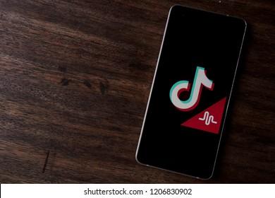 Bukit Lawang, Sumatra / Indonesia - October 19, 2018 - Tik Tok Musically social media application on smartphone screen close-up Android Google Play Store app on wooden table.