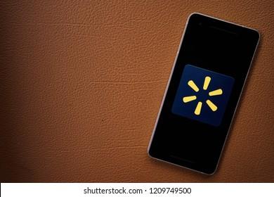 Bukit Lawang, Sumatra / Indonesia - October 23, 2018 - Walmart shopping application on smartphone screen close-up Android Google Play Store app.