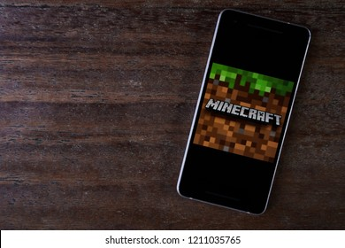 Bukit Lawang, Sumatra / Indonesia - October 24, 2018 - Minecraft game application on smartphone screen close-up Android Google Play Store app.