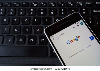 Bukit Lawang, Sumatra / Indonesia - October 27, 2018 - Google search on Google Chrome on smartphone screen close-up Android Google Play Store app.