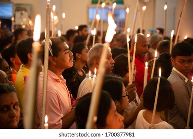 Bukit Mertajam, Penang/Malaysia - Jul 30 2016: Prayer with candles during St Anne feast in church.