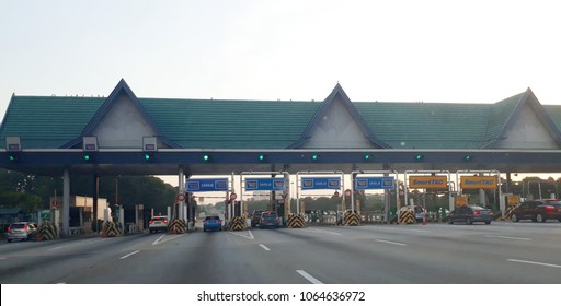 BUKIT RAJA KLANG, SELANGOR, MALAYSIA, APRIL 9,2018: Cars entering toll gate at North Klang Valley highway in the evening