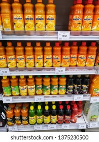 Bukit Raja, Malaysia - 9 April 2019 : Assorted of refreshment SUNQUICK juices bottle drinks display for sell in the supermarket shelves with selective focus.Mobile photoghpy.