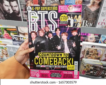 Bukit Tinggi, Malaysia - 23 February 2020 : Hand hold a BTS K-Pop Superstars Magazine for sell in the book stores with selective focus